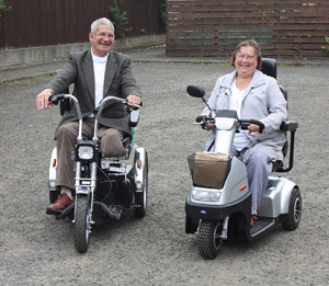 Adrian and Phyllis Spriggs from Dundee venture out together once more on their new 'easy rider' TGA mobility scooters
