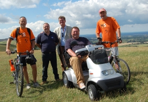 James Pagram, 48 living with MS from Eastbourne, successfully drove 101 miles along the South Downs Way on a TGA Breeze mobility scooter between 9-12th August to raise funds for the MS Society. James is pictured here on his TGA Breeze alongside Stephen Lloyd MP (centre), Craig Seaman, TGA Mobility engineer (centre left) and his two support riders.